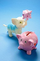 Piggybanks and toy elephant