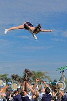 Cheerleader flying during a college parade in San Diego, California