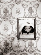 A photo of an infant child portriat is captured with a blurred effect