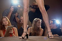 Low section view of a woman´s legs on a catwalk in a fashion show