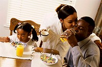 Close-up of parents with their daughter at the dining table