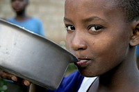 African girl eating. Tanzania