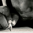 Boy at school writing. Tanzania