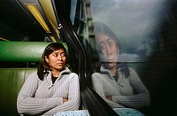 Asian woman on commuter train