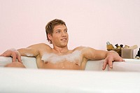 Man sitting in bathtub