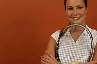 A female tennis player holding a racket