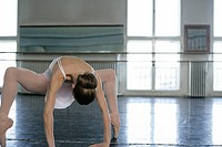 A female ballet dancer doing stretching exercises