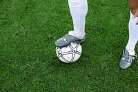 Soccer player's foot on a ball