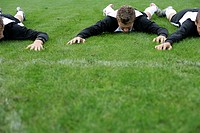 Soccer player lying on his stomach on grass
