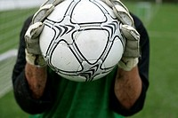 Goalkeeper holding football in his hands