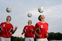 Soccer players doing header exercises
