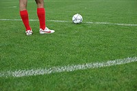 Soccer player preparing a free kick