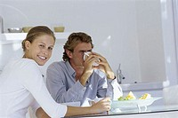 Young couple sitting at a breakfast table (thumbnail)