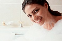 Portrait of a young woman taking a bubble bath (thumbnail)