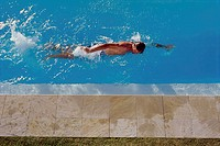 High angle view of a young man swimming in a pool