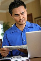 Young man looking at a laptop