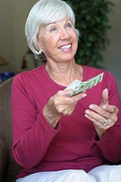 Senior woman holding money