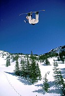 Snowboarder performing stunt in midair