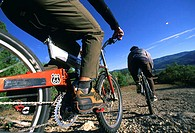 Two people mountain biking (thumbnail)
