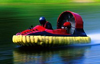 Side profile of a person riding a hovercraft