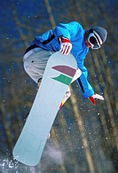 Low angle view of a man snowboarding (thumbnail)