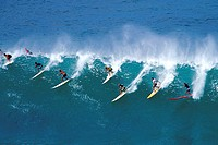 High angle view of a group of people surfing in the sea