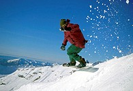 Side profile of a man snowboarding