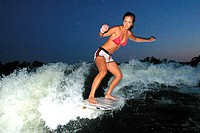 Young woman surfing in the sea