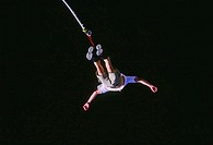 High angle view of a man bungee jumping
