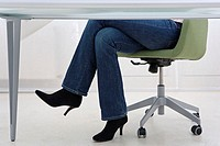 Legs of a woman under desk