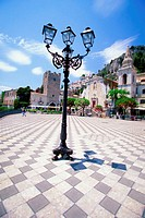 Lamp post in front of San Giuseppe Torre dell Orologio Tower, Piazza IX Aprile, Taormina, Sicily, Italy