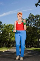 Senior adult woman jogging in park