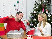 Couple wrapping christmas presents