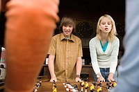 Four teenagers playing table football