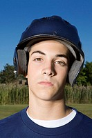 Portrait of a teenage boy wearing a helmet