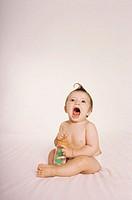 Baby holding baby bottle