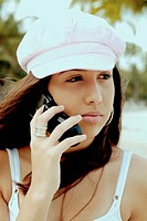Hispanic teenage girl on cell phone