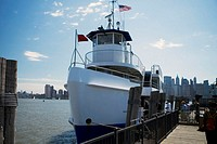 People boarding ferry in New York City, NY, USA