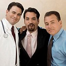 Portrait of a male doctor with two businessmen