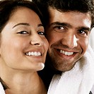 Close-up of a young couple smiling