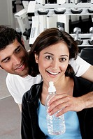 Close-up of a young couple smiling in a gym