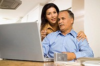 Low angle view of a mature couple in front of a laptop