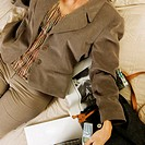 High angle view of a businesswoman sleeping on a bed