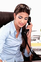 Businesswoman talking on a landline phone