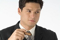 Businessman holding cigar, close-up