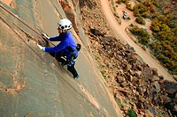 Female climber on route at the Ice Cream Parlor crag near Moab, Utah, USA