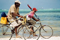 Fishermen going home by bike. Zanzibar, Tanzania