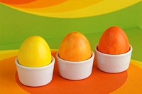 Easter eggs and orange coloured background