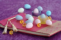 Coloured Easter eggs on book