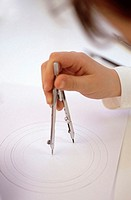 Boy (8-9) using compass, close-up